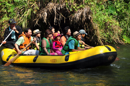 thai people rafting boat on the river thailand