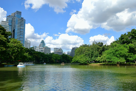 lumpini: Lake view of Lumpini Park in the Thai capitals city centre on october 10, 2014 in Bangkok, Thailand. Lumpini Park covers 142 acres with 2.5 km of pathways and a large boating lake.