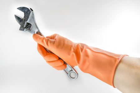 hand tool: wrench in a orange glove