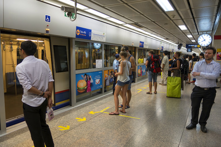 BANGKOK : Passengers on a Metropolitan Rapid Transit (MRT) subway train on 26 february 2015 in Bangkok. Thailand. The MRT serves 240,000 people daily with 18 stations and 27 km of track.