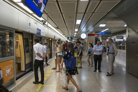 BANGKOK : Passengers on a Metropolitan Rapid Transit (MRT) subway train on 26 february 2015 in Bangkok. Thailand. The MRT serves 240,000 people daily with 18 stations and 27 km of track. Stok Fotoğraf - 47977468