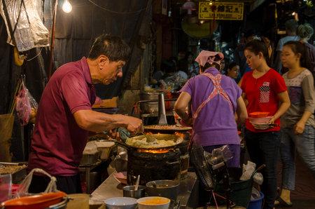 streetlife: Bangkok, Thailand - 31 January 2015 : chinese chef cooking a chinese food at bangkok chinatown on Yaowarat Road, many chinese food vendor around bangkok chinatown. Editorial