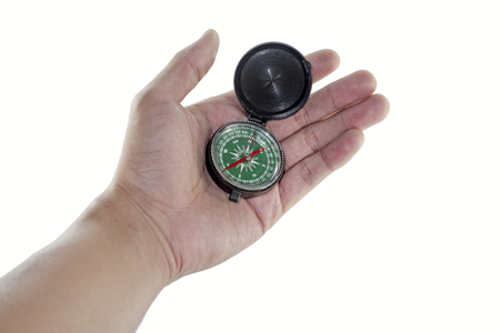 azimuth: hand holding a compass Stock Photo