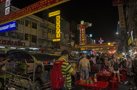 streetlife: Bangkok, Thailand - 31 January 2015 : People come to shopping at bangkok chinatown on Yaowarat Road,There are many small streets and alleys full of shops and vendors selling all types of goods.