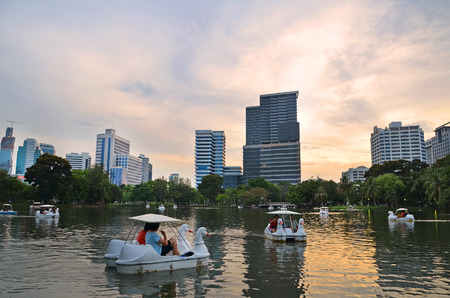 lumpini: BANGKOK - july 3: Lake view of Lumpini Park in the Thai capitals city centre on july 3, 2014 in Bangkok, Thailand. Lumpini Park covers 142 acres with 2.5 km of pathways and a large boating lake. Editorial