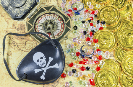 eye patch: pirate eye patch compass keys and octopus necklace and golden pirate coins on a old world map