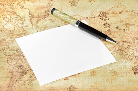 old world: Paper and pen on a old world map