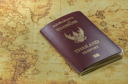 old world: Thailand passport on a old world map