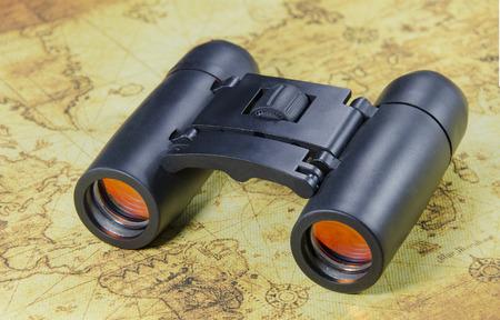old world: binocular on a old world map Stock Photo