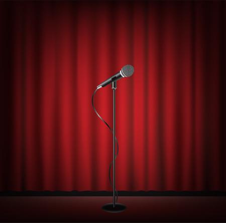 microfoonstandaard op een podium met rood gordijn backgrond