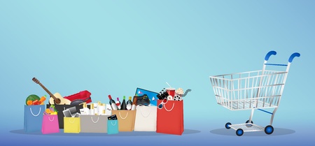 Shopping bags with many item inside with shopping cart