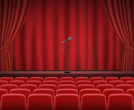 Rijen van rode bioscoop of theater zitplaatsen in de voorkant van de show het podium met microfoon