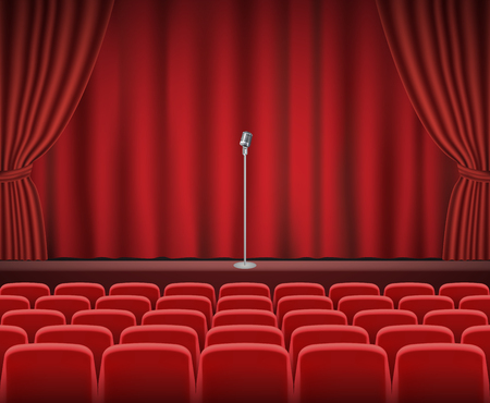 theater seats: Rows of red cinema or theater seats in front of show stage with retro microphone