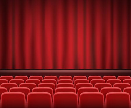theater seats: Rows of red cinema or theater seats in front of show stage