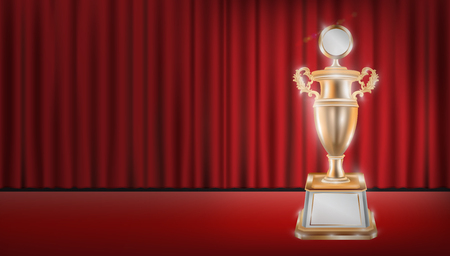 real trophy: real bronze trophy with red curtain stage background