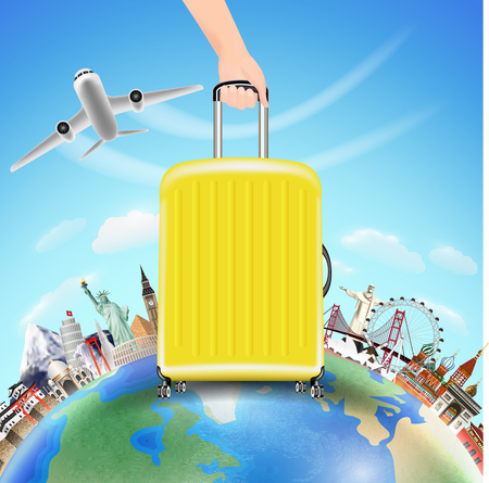 A hand pick suitcase with world travel landmark