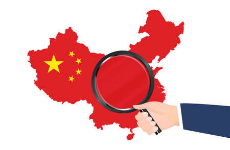 China map with flag and a hand holding a magnifying glass.