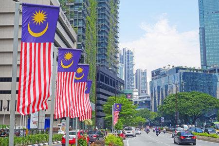MALAYSIA, KUALA LUMPUR - 16 October   2018. Malaysia Flag side of street near The Petronas Twin Towers Editorial