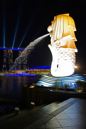 Singapore - 13 Ocbtober 2018: statue Singapore Merlion in Marina Bay sea. Merlion has a lions head and fish body and its spouting water from its mouth.