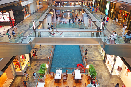 SINGAPORE - 12 October 2018: Canal and boat at The Shoppes at Marina Bay Sands Shopping Center in Singapore Editorial
