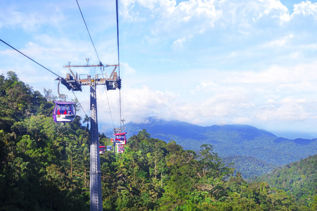 GENTING HIGHLANDS, MALAYSIA - 16 DECEMBER 2018 : Tourists travel on cable car of Genting Skyway. It is a gondola lift connecting Gohtong Jaya and Genting Highland. Editorial