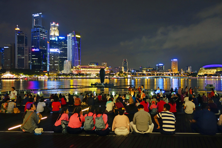 SINGAPORE -14  October 2018 : Many audiences are watching Light and water show, Songs of the sea at the front of Marina Bay Sands in SingaporeSINGAPORE -14  October 2018 : Many audiences are watching Light and water show, Songs of the sea at the front of