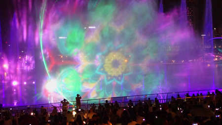 SINGAPORE -14  October 2018 : Many audiences are watching Light and water show, Songs of the sea at the front of Marina Bay Sands in Singapore
