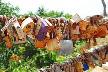 master key lock by lover couple at Noen Nangphaya View Point , Chanthaburi, Thailand. Banco de Imagens