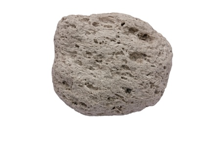 stone volcanic stones: Pumice from Santorini Greece  The width of the specimen is 40 mm  This piece of pumice is approximately 3,600 years old  It was formed by the Minoan volcanic eruption - one of the most powerful volcanic eruptions in historical time that most likely also d Stock Photo