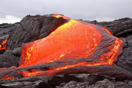 volcano: Glowing lava forming new land in Hawaii. Kilauea volcano, Puu Oo vent. Stock Photo