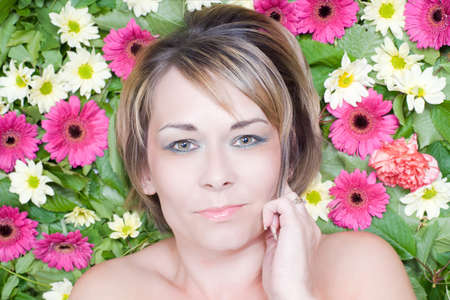 Attractive woman lying on a bed of flowers Stock Photo - 9809731