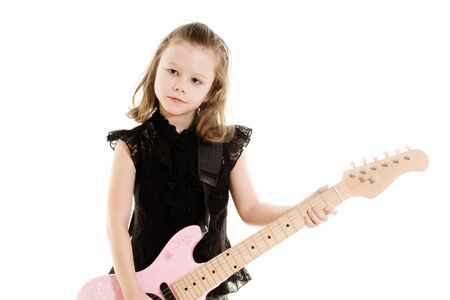 young girl playing guitar Stock Photo