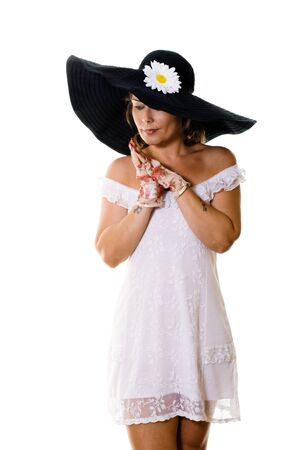 Attractive woman in white dress and large black hat Stock Photo - 9939407