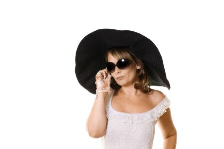 Attractive woman in large black hat and sunglasses