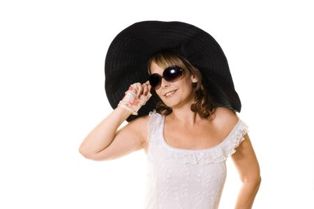 smiling woman in black hat and sunglasses