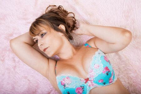 woman in lingerie lying on pink fur
