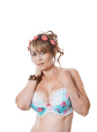 woman wearing lingerie and flowered headband Stock Photo
