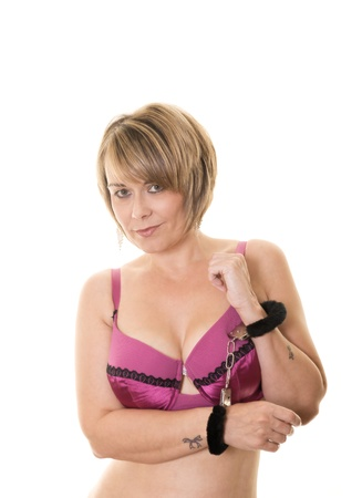 portrait of woman in lingerie and furry handcuffs isolated on white Stock Photo - 10048607
