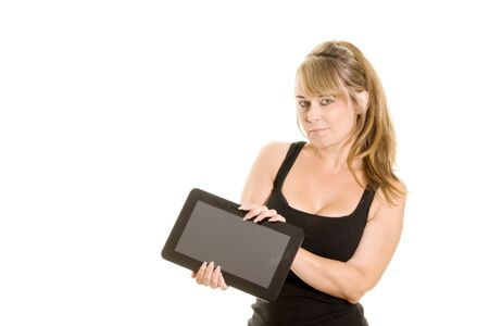 Studio portrait of woman holding a tablet computer isolated on white