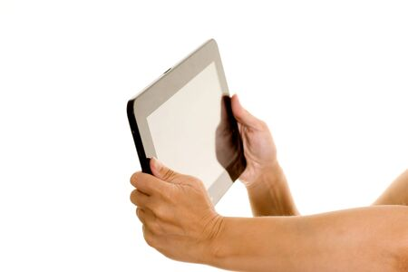 Womans hands holding a tablet computer isolated on white Stock Photo