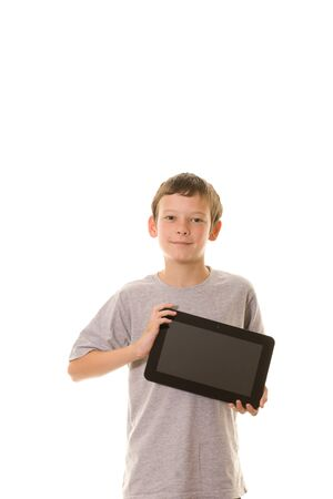 Young boy holding a tablet computer