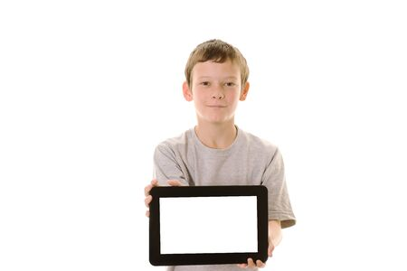 Young boy holding a tablet computer with copy space Stock Photo - 10274816