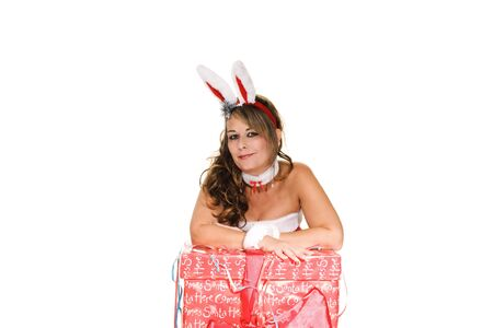 Woman in christmas outfit with a large present Stock Photo