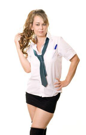 Studio portrait of a woman dressed as a schoolgirl