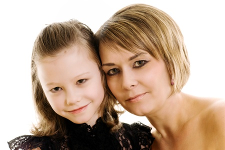 studio photo of a mother and daughter isolated on white Stock Photo