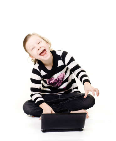 young girl happily using a computer Stock Photo - 12605273