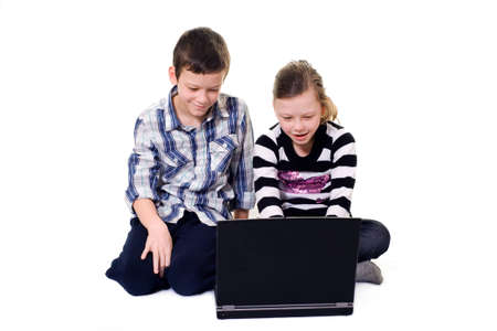 netbook: brother and sister using a computer Stock Photo