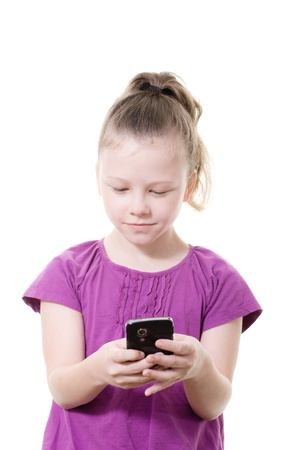 young girl sending a text message