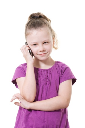 young girl using a mobile phone photo