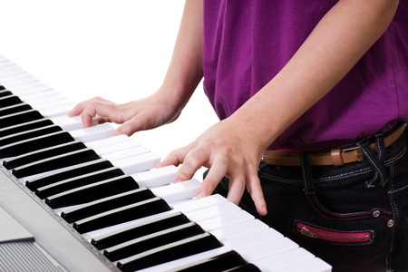 close up of young girl  playing keyboard